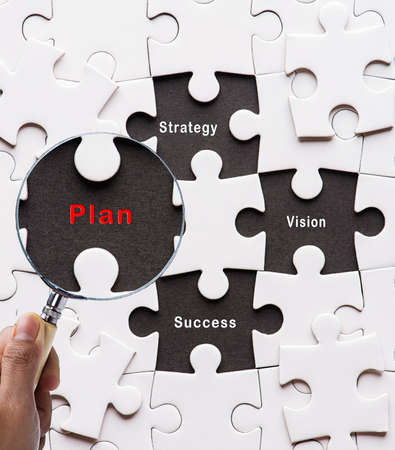 peace plan: Magnifying glass searching missing puzzle peace Plan,Strategy,Vision,Success