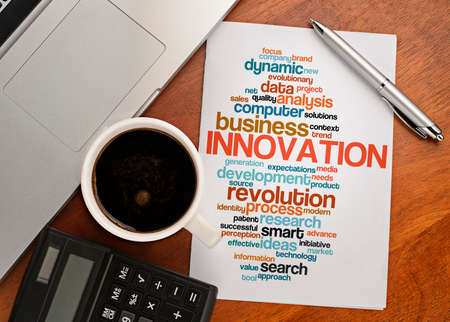 innovation word: INNOVATION word cloud arrangement Notebook with text vision on table with coffee, calculator and notebook