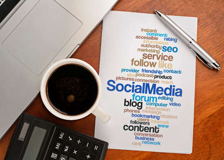 tweets: SOCIAL MEDIA word cloud arrangement Notebook with text vision on table with coffee, calculator and notebook Stock Photo