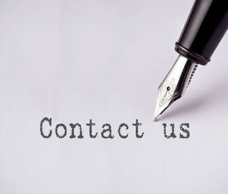 contactus: Pen writes contact us on paper