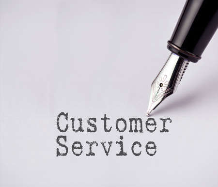 specifying: Pen writes customer service on paper Stock Photo