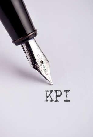 kpi: KPI with pen written on paper Stock Photo