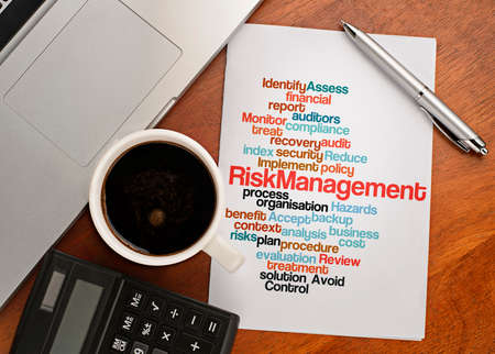 RISK MANAGEMENT word cloud arrangement Notebook with text vision on table with coffee, calculator and notebook Stock Photo