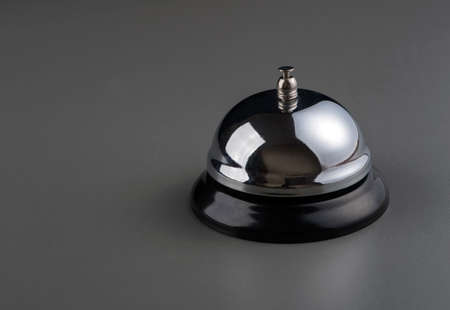bell: service bell over dark grey background Stock Photo