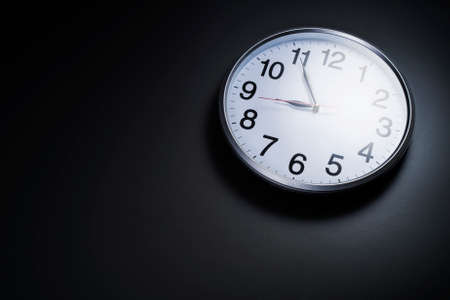 room for text: Image of clock on with left space room for text