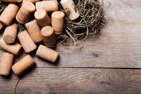 wine growing: cork in upper corner with straw on wood