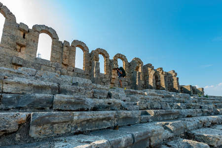 Aksu, Antalya / Turkey. A hiker in Perge (Perga Ancient City) Ancient City and Ruins.
