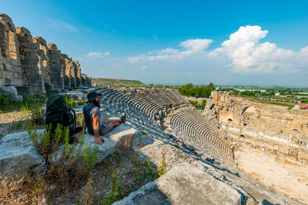 A hiker in Perge (Perga Ancient City) Ancient City and Ruins.