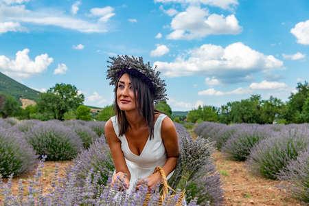 Turkey's lavender paradise: Kuyucak Village, Isparta - Turkey. Beautiful woman in the lavander field of the Kuyucak Isparta. Woman model is walking through lavender fields.