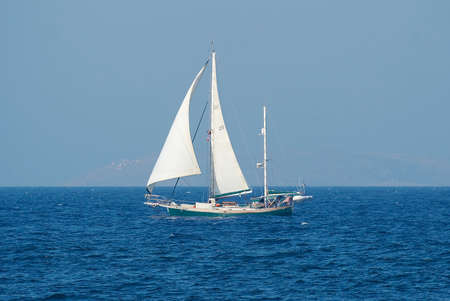Sailboat seen from shore