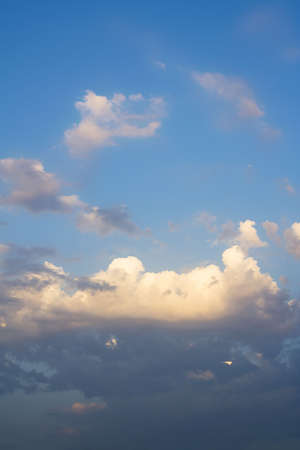 Lots of clouds of a beautiful summer sky. It is almost sunset. Stock Photo