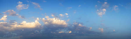 Panaromic view of clouds of a beautiful summer sky. It is almost sunset. Stock Photo