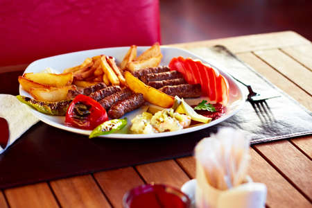 A beautiful plate full of delicious Turkish Kofte (meatballs). photo