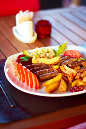 A beautiful plate full of delicious Turkish Kofte (meatballs).