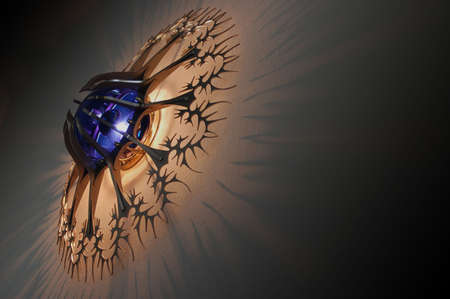 designer lamp with blue light casting shadows on the wall photo