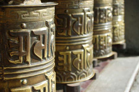 prayer wheels in front of temple in thailand