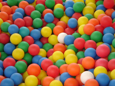 colored plastic balls in bouncy castle photo