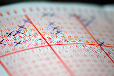 lottery ticket with digits and crosses
