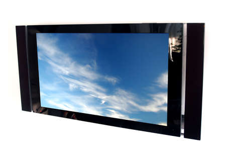 glossy black plasma tv screen with picture of blue sky Stock Photo