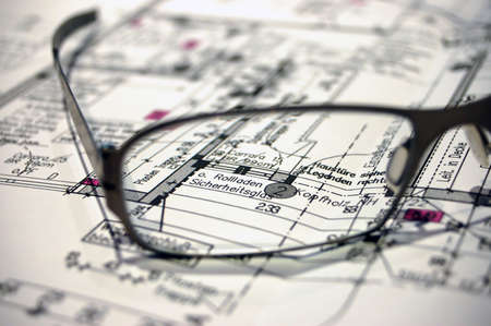 construction plan with eyeglasses
