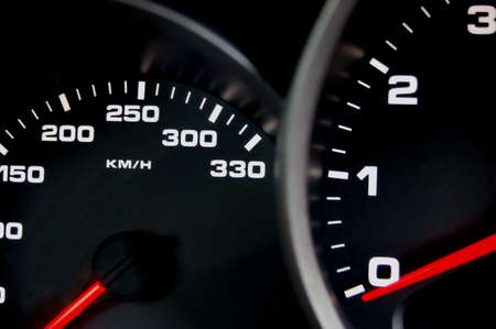 Sportscar dashboard closeup with backlit speedometer Stock Photo
