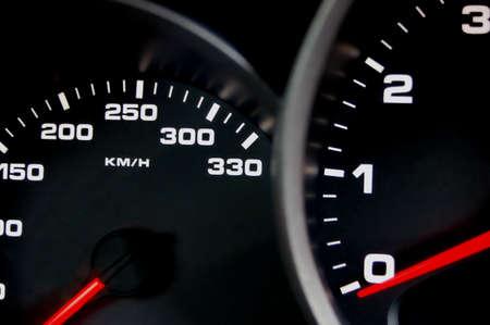 Sportscar dashboard closeup with backlit speedometer Stock Photo