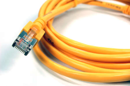 Yellow RJ45 Network Cable on white background Standard-Bild