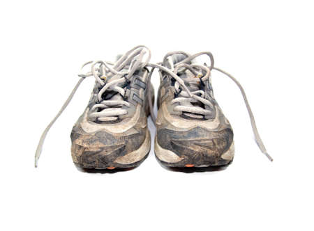worn our jogging shoes with mud, isolated on white background Stock Photo
