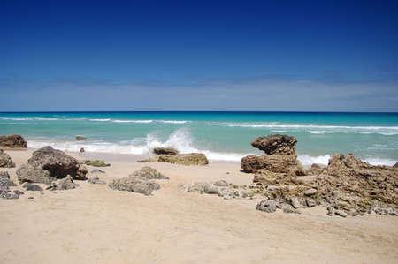 beach with rocks and blue sky