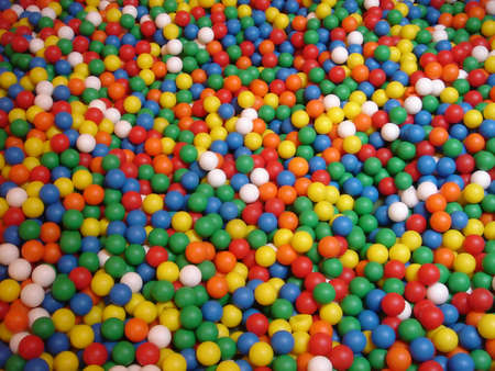 coloured plastic balls in bouncy castle Stock Photo