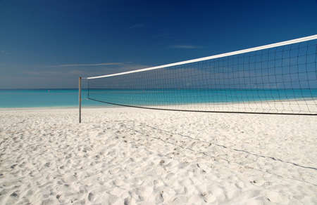 Beach Volleyball net on white sand