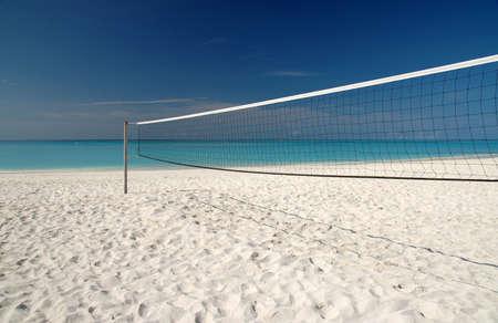 Beach Volleyball net on white sand