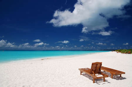 canvas chairs on tropical beach