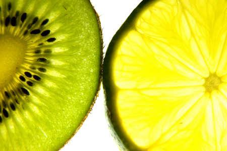 closeup of backlit kiwi and lime slices photo
