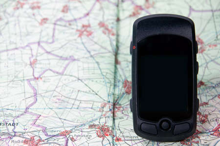 handheld gps on a route map