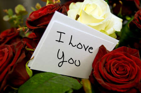 bouquet of roses with i love you card