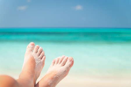 sandy feet: sandy feet on the beach Stock Photo