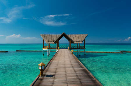 Jetty over the turquoise indian ocean on the maldives