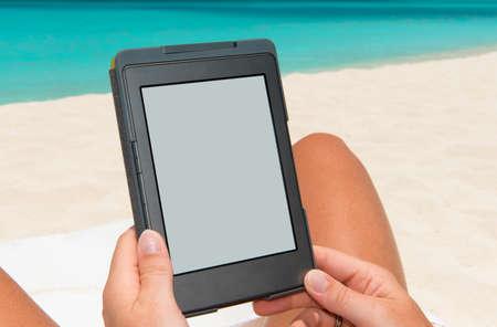 e reader: e-book reader at the beach