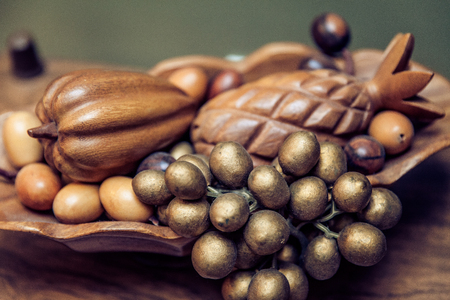 bronze bowl: Wood Carved Fruit Bowl Stock Photo