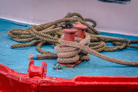 fixed line: Red bollard on board at the old harbor of dunbar, scottland