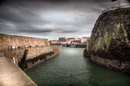 Dunbar Castle Ruinsand a view in the harbor of dunbar East Lothian. Scotland Stock Photo