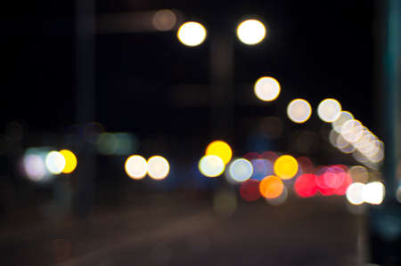 Evening traffic. The city lights. Motion blur and bokeh effect viewed from the road Stock Photo