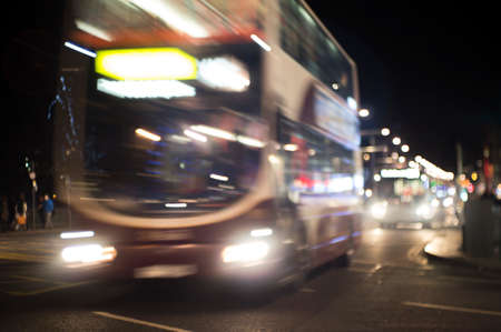 nimbus: Evening traffic. The city lights. Motion blur and bokeh effect viewed from the road Stock Photo
