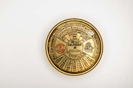 everlasting calendar old golden diary almanac isolated on white background