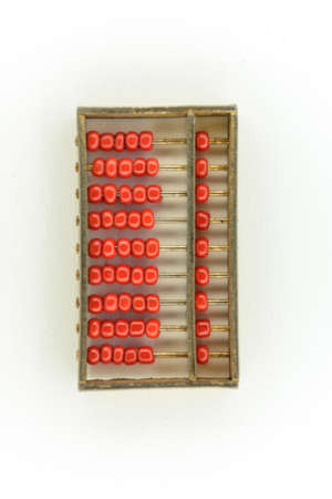 ciphering: abacus of many red beads in gold on white background Stock Photo