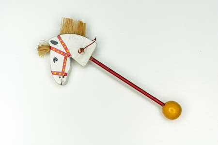 whitewood horsehead on stick vintage toy isolated on white background