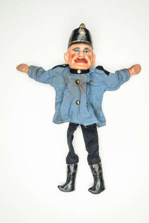 very old puppet hand puppet Doll, police officer on white background