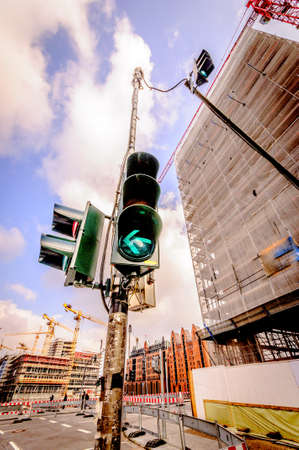 Traffic lights with arrow, green light in the city