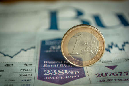 Euro coin money (EUR), currency of European Union, Germany isolated over white business newspaper background Stock Photo
